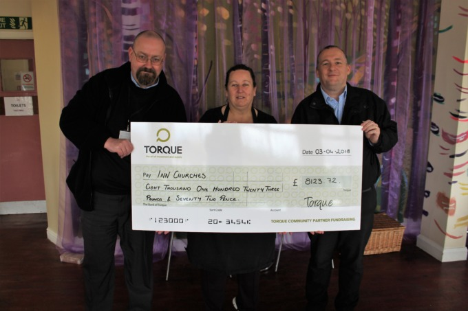 Torque cheque handover to one of its 2017/18 community partners, Inn Churches.